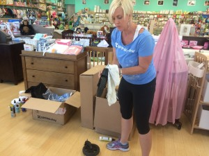 Ms. Osborne performing a stroller tune-up at Baby World in Oakland, Calif.